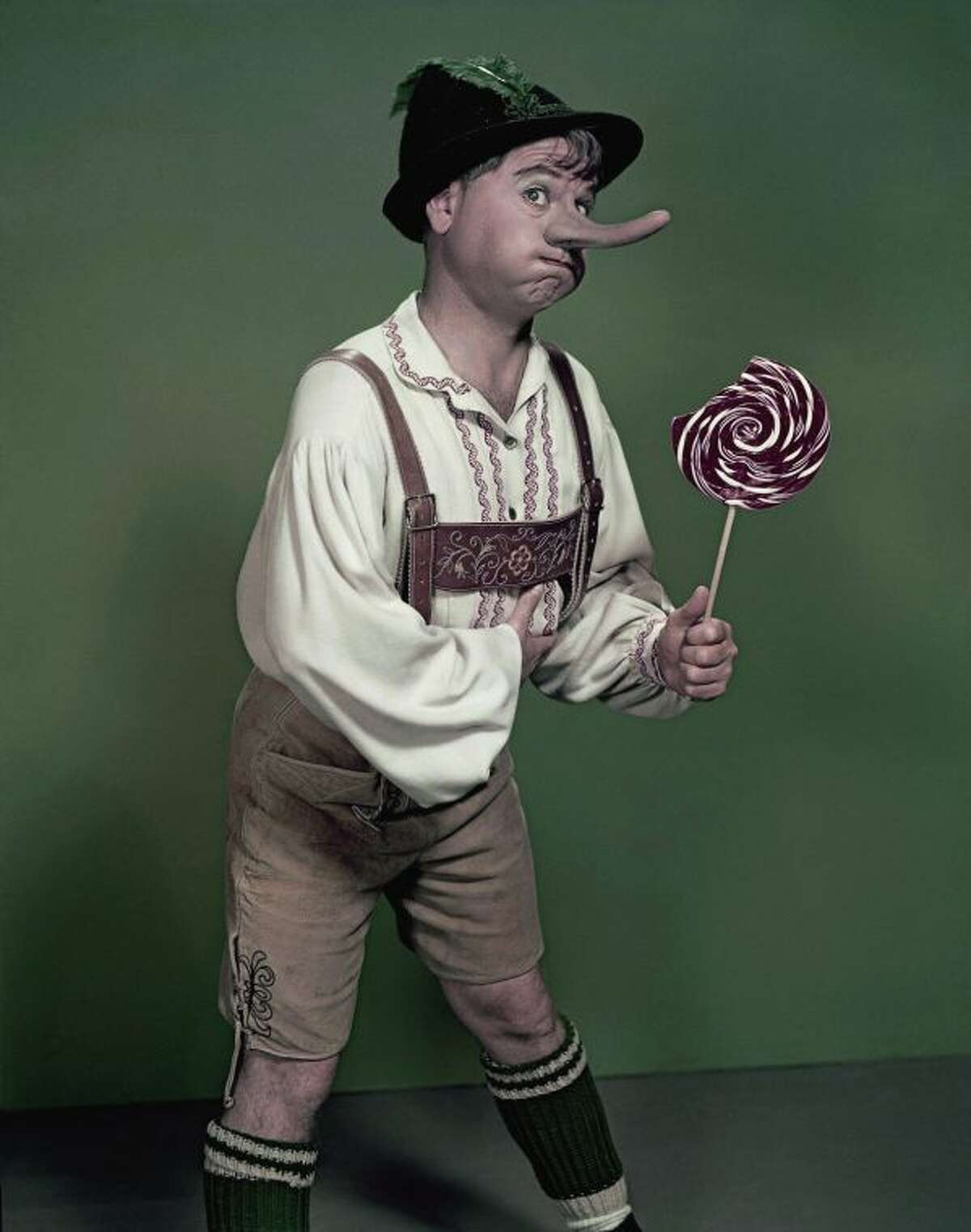 """FILE - Actor Mickey Rooney portrays """"Pinnochio,"""" in this September 1957, file photo. Rooney, a Hollywood legend whose career spanned more than 80 years, has died. He was 93. Los Angeles Police Commander Andrew Smith said that Rooney was with his family when he died Sunday, April 6, 2014, at his North Hollywood home. (AP Photo/File)"""