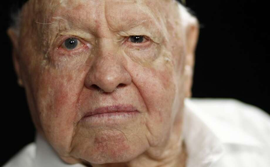 FILE - In this Thursday, May 19, 2011, file photo, actor Mickey Rooney poses during a portrait session in Los Angeles. Rooney, a Hollywood legend whose career spanned more than 80 years, has died. He was 93. Los Angeles Police Commander Andrew Smith said that Rooney was with his family when he died Sunday, April 6, 2014, at his North Hollywood home. (AP Photo/Matt Sayles, File)