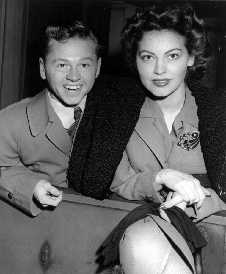 FILE - Mickey Rooney and wife, Ava Gardner, arrive in New York in January 1942, en route to Boston where Rooney is to appear at a Red Cross benefit. Rooney, a Hollywood legend whose career spanned more than 80 years, has died. He was 93. Los Angeles Police Commander Andrew Smith said that Rooney was with his family when he died Sunday, April 6, 2014, at his North Hollywood home. (AP Photo/File)