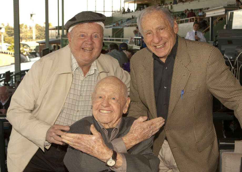 Entertainment icons Dick Van Patten, left, and Mel Brooks flank Micskey Rooney in this Sunday, March 30, 2014 photo taken at Santa Anita Park, Arcadia CA. (AP Photo/Benoit Photo)
