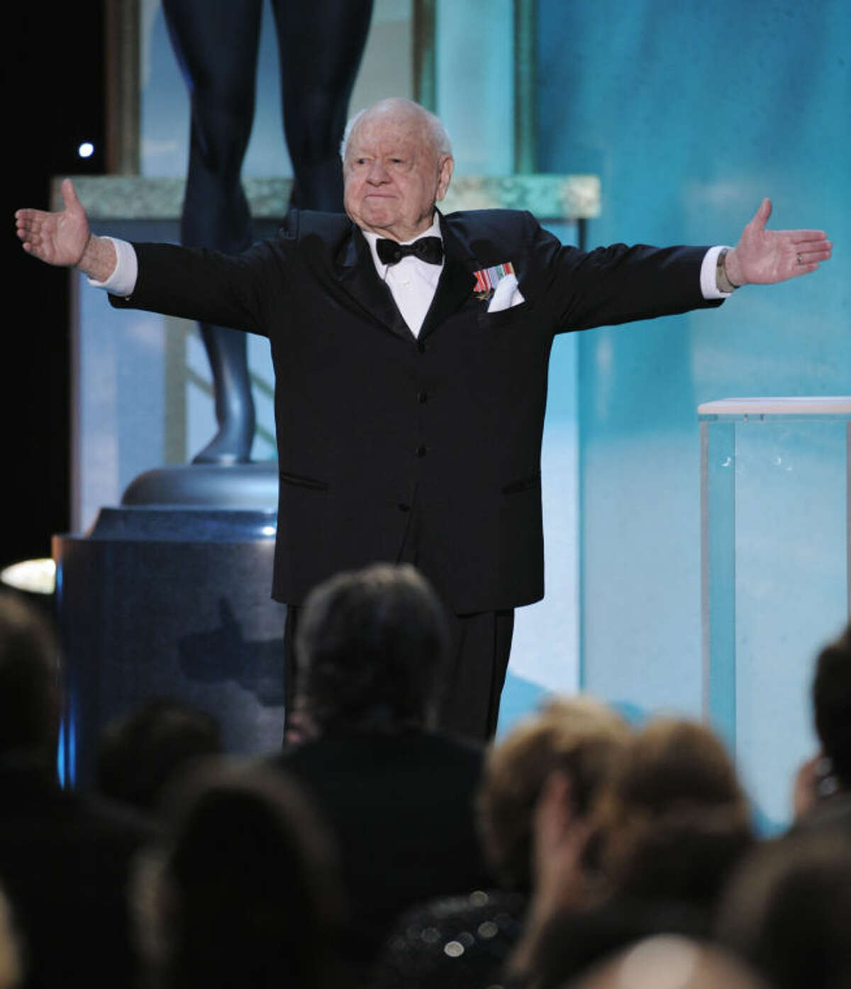 FILE - In this Sunday, Jan. 27, 2008, file photo, Mickey Rooney takes the stage to make an award presentation at the 14th Annual Screen Actors Guild Awards, in Los Angeles. Rooney, a Hollywood legend whose career spanned more than 80 years, has died. He was 93. Los Angeles Police Commander Andrew Smith said that Rooney was with his family when he died Sunday, April 6, 2014, at his North Hollywood home. (AP Photo/Mark J. Terrill, File)