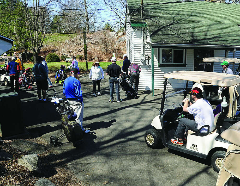 Golf carts line up Sunday as the official season has started at Oak Hills Golf Course in Norwalk. Hour photo/Matthew Vinci