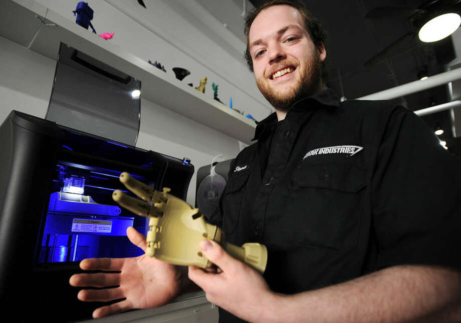 Manager Stephen Vermilyea, of Norwalk, shows a prosthetic hand and arm that he is producing through 3-D printing technology at Industrial C.H.I.M.P. at 132A Washington Street in Norwalk, Conn. on Wednesday, April 6, 2016.