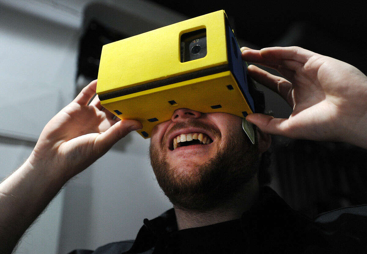 Manager Stephen Vermilyea, of Norwalk, demonstrates the Google Cardboard virtual reality viewer at Industrial C.H.I.M.P. at 132A Washington Street in Norwalk, Conn. on Wednesday, April 6, 2016.