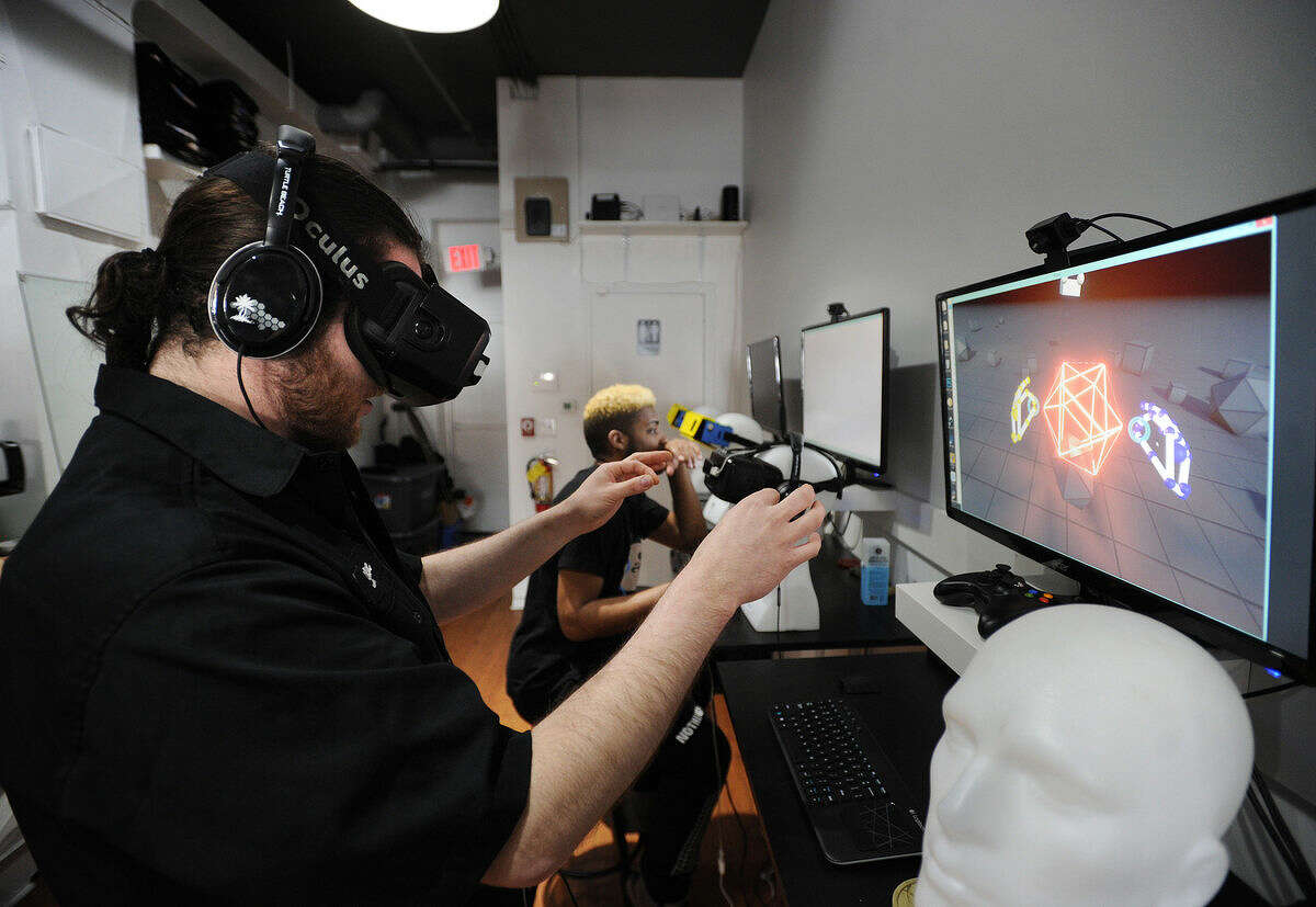 Manager Stephen Vermilyea, of Norwalk, demonstrates the Oculus Rift virtual reality technology at Industrial C.H.I.M.P. at 132A Washington Street in Norwalk, Conn. on Wednesday, April 6, 2016.