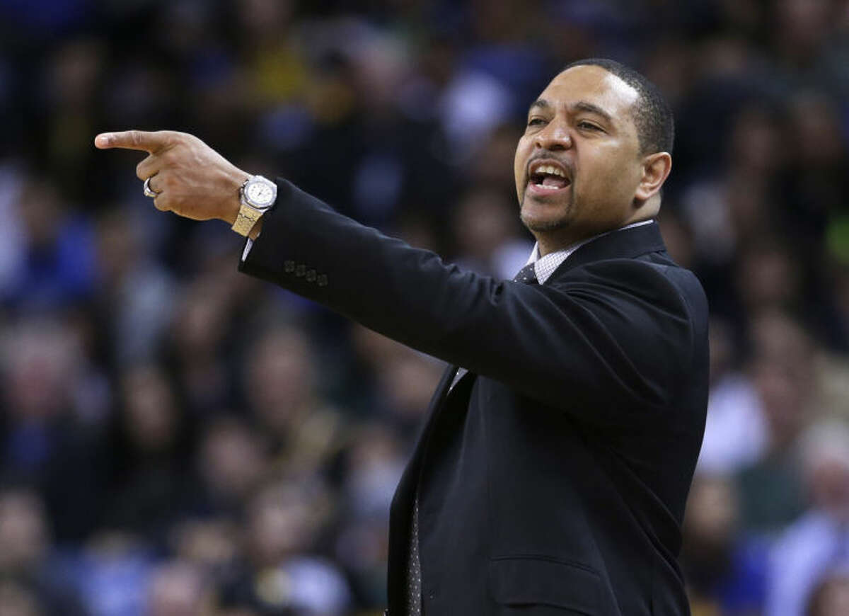 Golden State Warriors coach Mark Jackson directs his team against the Sacramento Kings during the first half of an NBA basketball game Friday, April 4, 2014, in Oakland, Calif. (AP Photo/Marcio Jose Sanchez)