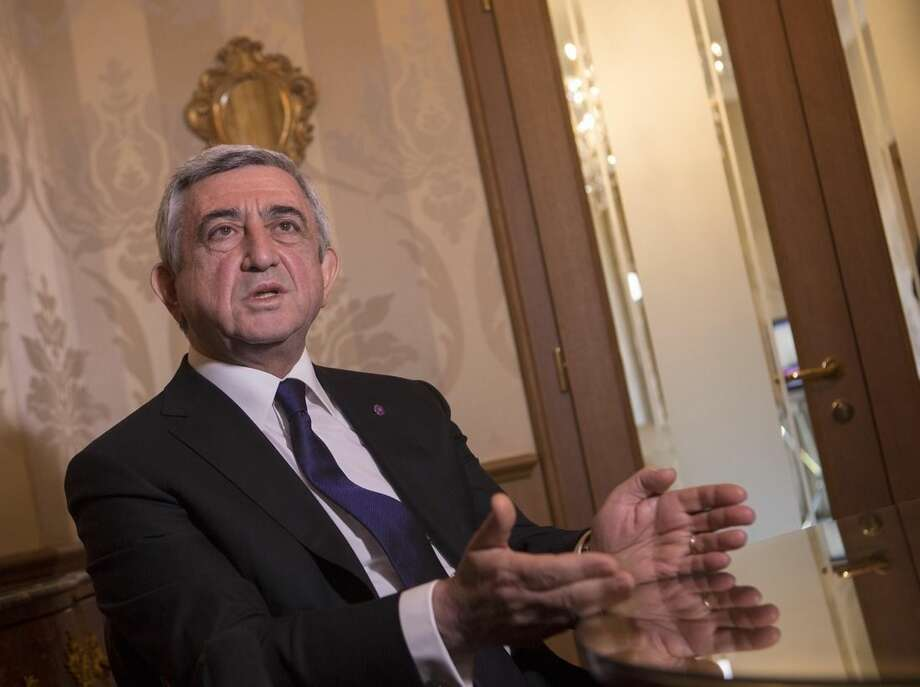 """Armenian President Serzh Sargsyan speaks during an interview with The Associated Press in Rome, Sunday, April 12, 2015. Pope Francis sparked a diplomatic incident with Turkey on Sunday by calling the slaughter of Armenians by Ottoman Turks """"the first genocide of the 20th century"""" and urging the international community to recognize it as such. Turkey, which denies a genocide took place, immediately summoned the Vatican ambassador to express its displeasure, a Foreign Ministry spokesman said in Ankara, speaking on customary condition of anonymity. (AP Photo/Riccardo De Luca)"""
