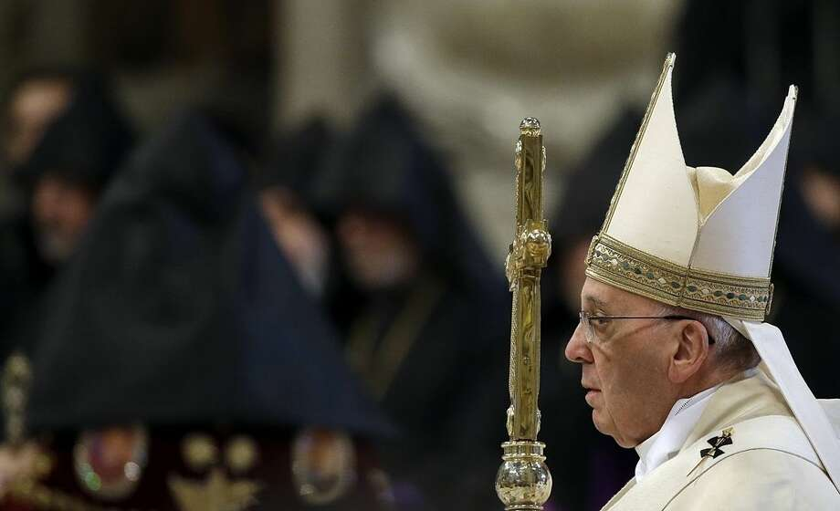 Pope Francis arrives to celebrates an Armenian-Rite Mass on the occasion of the commemoration of the 100th anniversary of the Armenian Genocide, in St. Peter's Basilica, at the Vatican Sunday, April 12, 2015. Historians estimate that up to 1.5 million Armenians were killed by Ottoman Turks around the time of World War I, an event widely viewed by genocide scholars as the first genocide of the 20th century. Turkey however denies that the deaths constituted genocide, saying the toll has been inflated, and that those killed were victims of civil war and unrest. (AP Photo/Gregorio Borgia)