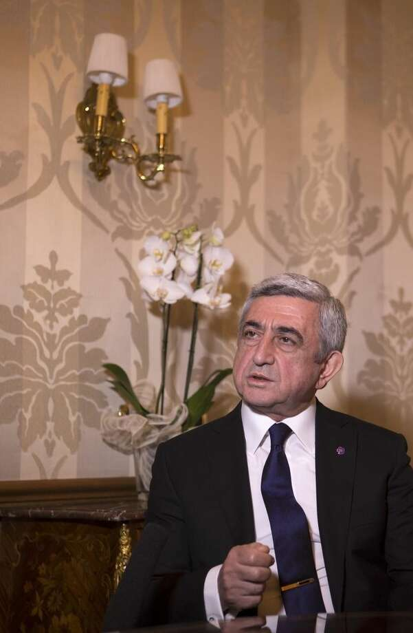 "Armenian President Serzh Sargsyan speaks during an interview with The Associated Press in Rome, Sunday, April 12, 2015. Pope Francis sparked a diplomatic incident with Turkey on Sunday by calling the slaughter of Armenians by Ottoman Turks ""the first genocide of the 20th century"" and urging the international community to recognize it as such. Turkey, which denies a genocide took place, immediately summoned the Vatican ambassador to express its displeasure, a Foreign Ministry spokesman said in Ankara, speaking on customary condition of anonymity. (AP Photo/Riccardo De Luca)"