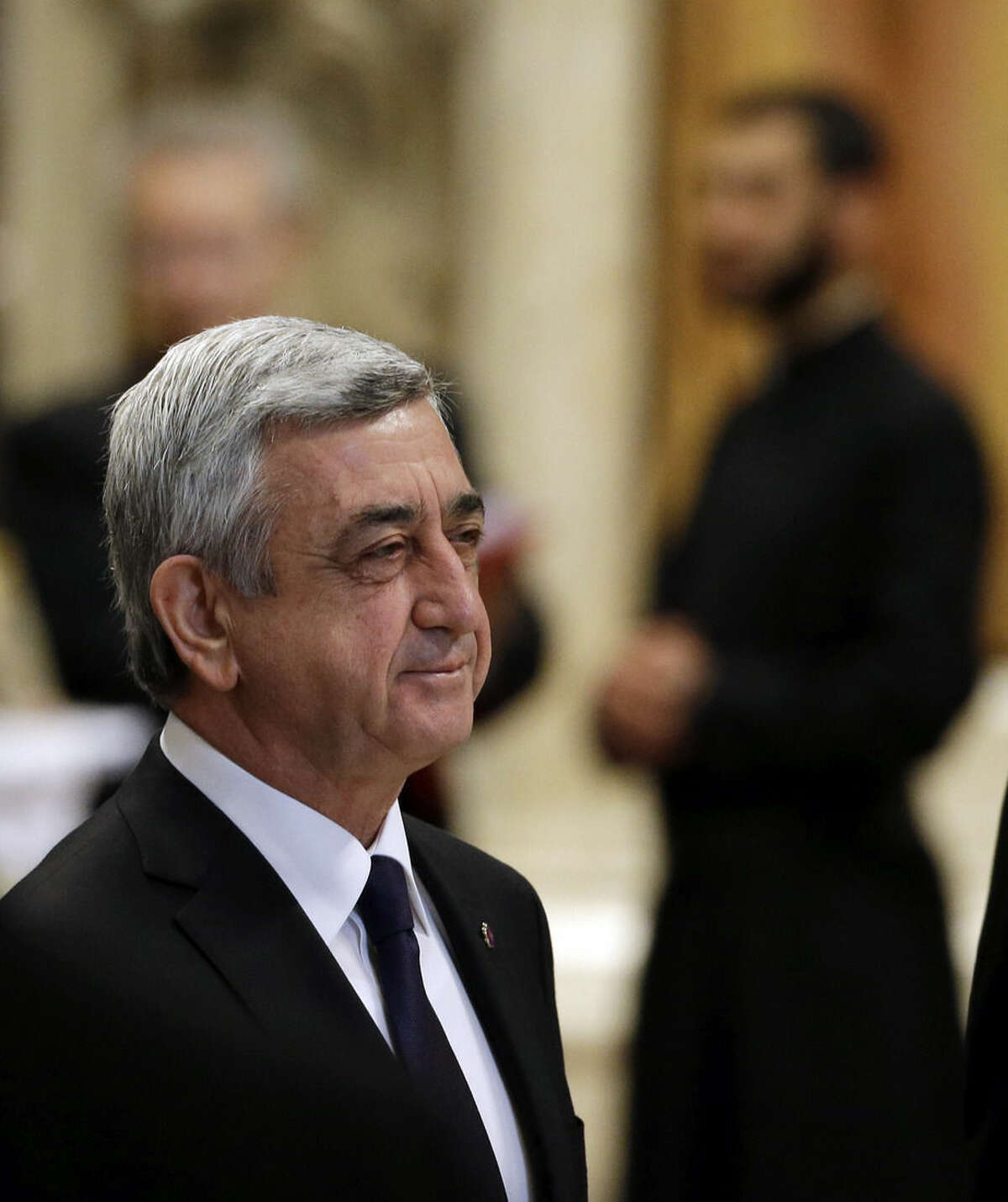 Armenian President Serzh Sargsyan arrives to attend an Armenian-Rite Mass celebrated by Pope Francis on the occasion of the commemoration of the 100th anniversary of the Armenian Genocide, in St. Peter's Basilica, at the Vatican, Sunday, April 12, 2015. Historians estimate that up to 1.5 million Armenians were killed by Ottoman Turks around the time of World War I, an event widely viewed by genocide scholars as the first genocide of the 20th century. Turkey however denies that the deaths constituted genocide, saying the toll has been inflated, and that those killed were victims of civil war and unrest. (AP Photo/Gregorio Borgia)