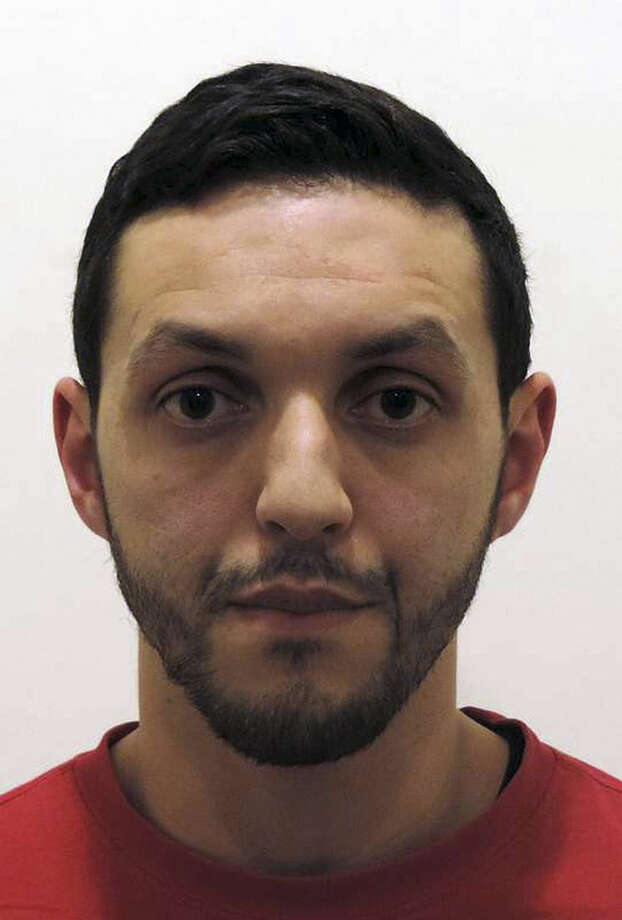 """FILE - This is an undated photograph provided by Belgian Federal Police shows Mohamed Abrini. Belgian authorities say several arrests have been made in relation to the Brussels attacks. The prosecutor's office said Friday April 8, 2016 that it made """"several arrests"""" Friday, one day after it called on the public to help look for a key suspect in the March 22 attacks that killed 32 people. Belgian broadcaster VRT, citing sources it did not identify, said Paris attacks suspect Mohamed Abrini was among those arrested. (Belgian Federal Police via AP)"""