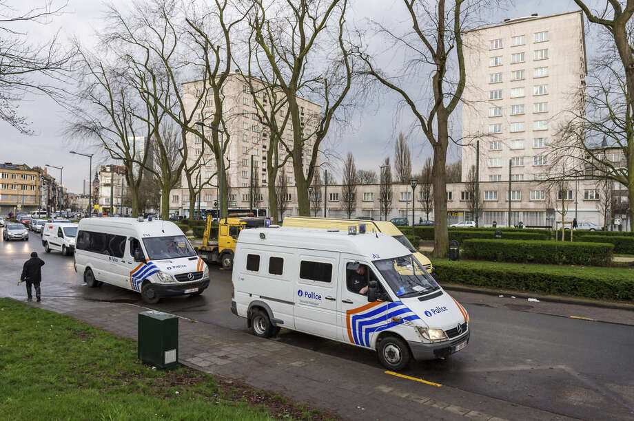 "Police secure an area where two terror suspects were arrested in Brussels on Friday April 8, 2016. A fugitive suspect in the Nov. 13 Paris attacks was arrested in Belgium on Friday, French police officials said, after a raid Belgian authorities said was linked to the deadly March 22 Brussels bombings. The suspect, Mohamed Abrini, is believed to be the mysterious ""man in the hat"" who escaped the double bombing at the Zaventem airport, according to one of the French officials.(AP Photo/Geert Vanden Wijngaert)"