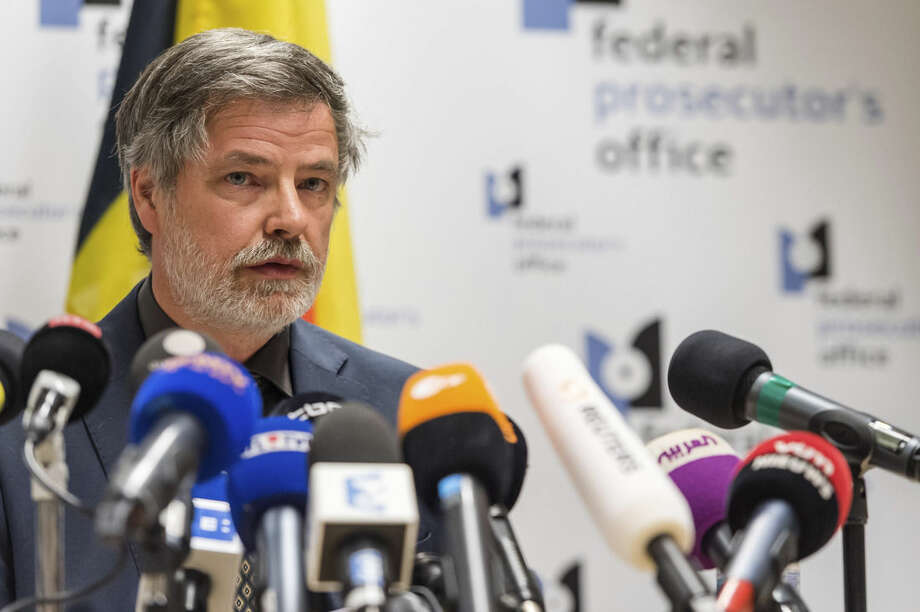 """Spokesman for the Belgian Federal Prosecutors Office Eric Van Der Sypt addresses the media during a press conference in Brussels on Friday April 8, 2016. The prosecutor's office confirmed a fugitive suspect in the Nov. 13 Paris attacks was arrested in Belgium on Friday, after a raid Belgian authorities said was linked to the deadly March 22 Brussels bombings. The suspect, Mohamed Abrini, is believed to be the mysterious """"man in the hat"""" who escaped the double bombing at Brussels airport, but further investigation is needed to determine Abrini is the third suspect of the airport attack. (AP Photo/Geert Vanden Wijngaert)"""