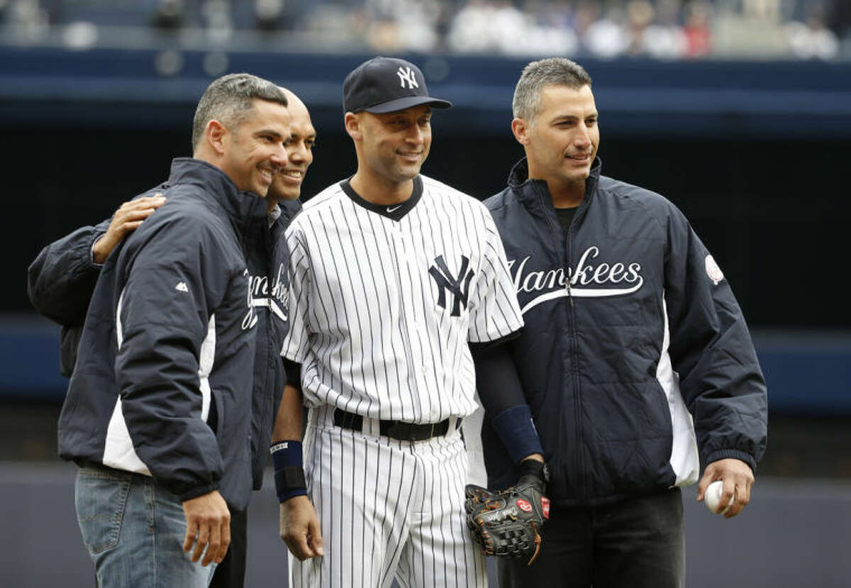 """Members of the Yankees """"Core Four,"""" from left, former Yankees catcher Jorge Posada, reliever Mariano Rivera, New York Yankees shortstop Derek Jeter, and former Yankees starting pitcher Andy Pettitte pose together after Rivera and Pettitte threw out the ceremonial first pitch to Jeter and Posada before a baseball game against the Baltimore Orioles, at Yankee Stadium in New York, Monday, April 7, 2014. (AP Photo/Kathy Willens)"""