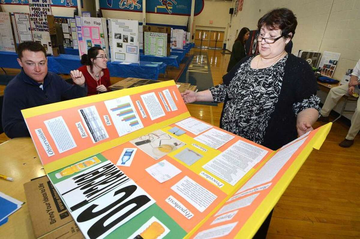 Hour Photo/Alex von Kleydorff Chemistry Teacher Annahit Pivazyan takes in the display boards from the students dropping them off for the Citywide Science Fair at Brien McMahon