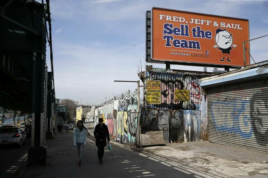 A billboard criticizing the ownership of the New York Mets is displayed across the street from Citi Field, Monday, April 13, 2015, in New York. (AP Photo/Seth Wenig)