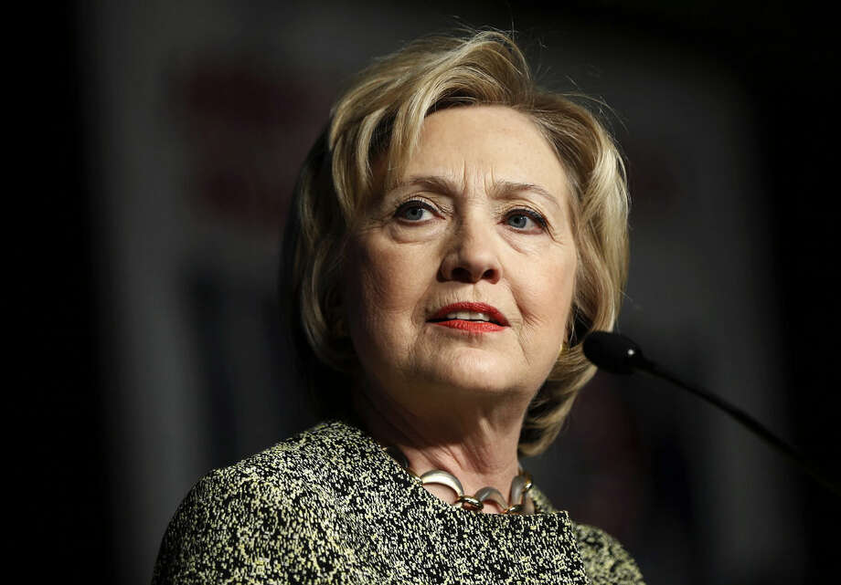 In this April 6, 2016, photo, Democratic presidential candidate Hillary Clinton speaks at the Pennsylvania AFL-CIO Convention in Philadelphia. A new Associated Press-GfK poll finds that Americans trust Democratic presidential front-runner Clinton more than Republican leader Donald Trump to handle a wide range of issues, from immigration to health care to nominating Supreme Court justices.(AP Photo/Matt Rourke)