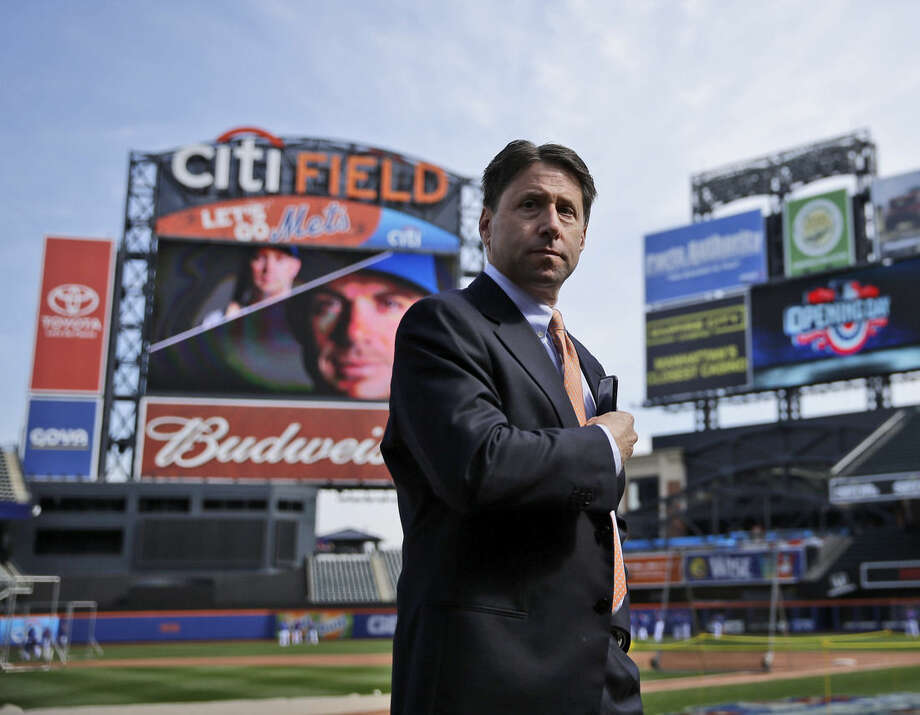 New York Mets co-owner Jeff Wilpon stands on the field before the Mets home opener baseball game against the Philadelphia Phillies at Citi Field, Monday, April 13, 2015 in New York. (AP Photo/Seth Wenig)