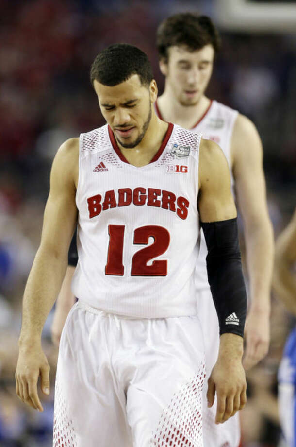 Wisconsin guard Traevon Jackson (12) winces after a play against Kentucky during the second half of the NCAA Final Four tournament college basketball semifinal game Saturday, April 5, 2014, in Arlington, Texas. (AP Photo/David J. Phillip)