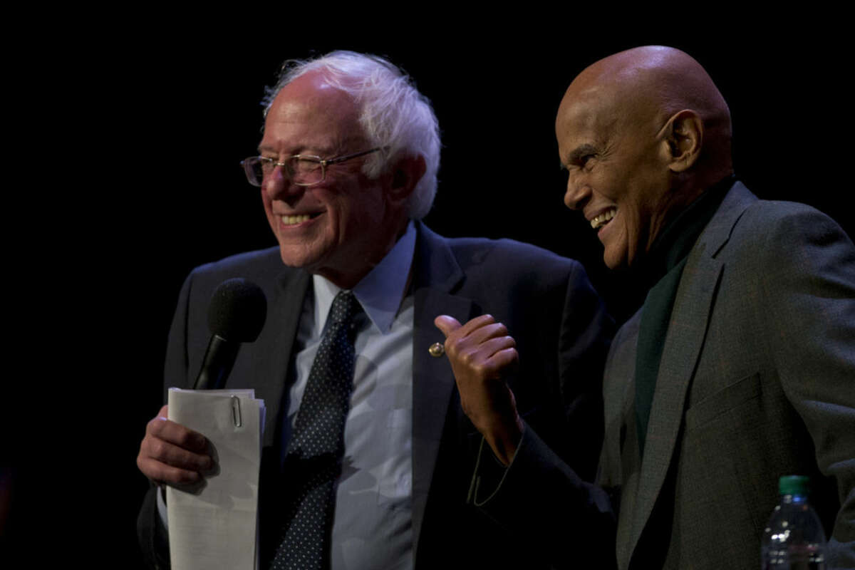 Democratic presidential candidate, Sen. Bernie Sanders, I-Vt., is joined on stage by Harry Belafonte as he speaks at a campaign event at the Apollo Theatre, Saturday, April 9, 2016, in the Harlem neighborhood of Manhattan. (AP Photo/Mary Altaffer)
