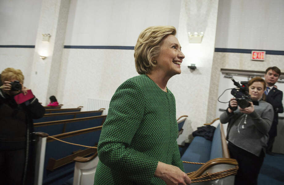 Democratic presidential candidate Hillary Clinton exits after speaking at New Greater Bethel Ministries during a campaign stop, Sunday, April, 10, 2016, in New York. (AP Photo/Bryan R. Smith)
