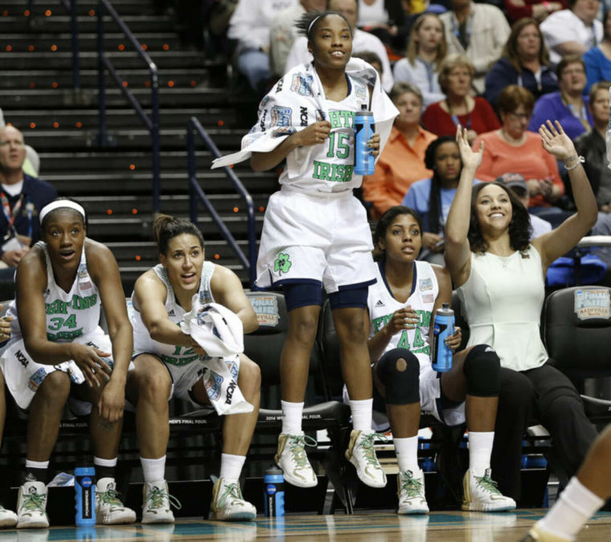 Notre Dame guard Lindsay Allen (15) celebrates a goal in the closing seconds of the second half of the semifinal game against Maryland in the Final Four of the NCAA women's college basketball tournament, Sunday, April 6, 2014, in Nashville, Tenn. Notre Dame won 87-61. (AP Photo/Mark Humphrey)