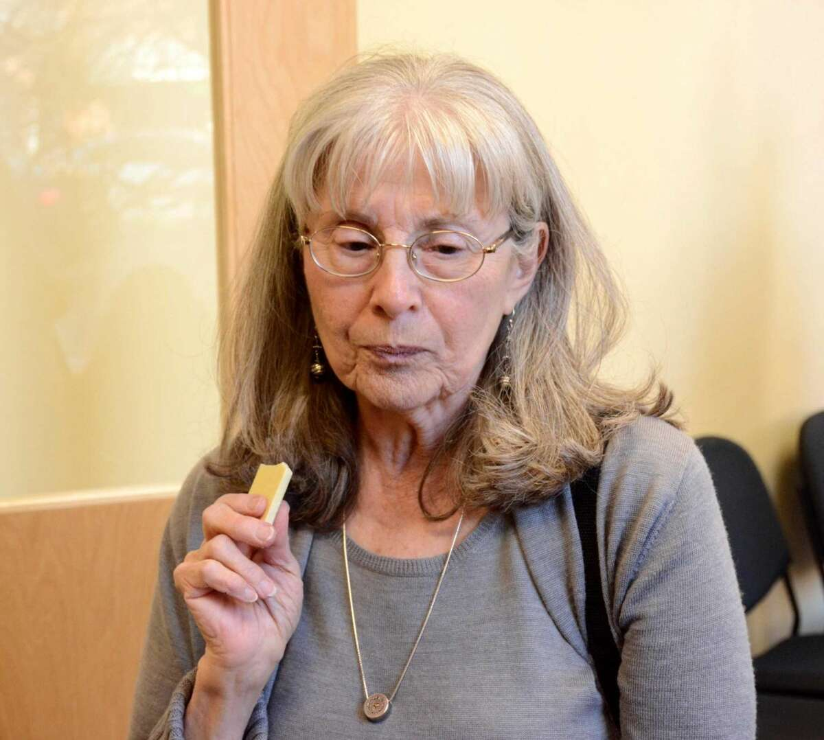 Roberta Roos from Dobbs Ferry NY takes a taste of a white chocolate sample at the kickstarter fundraiser held for Noteworthy Chocolates on Thursday April, 14,2016.