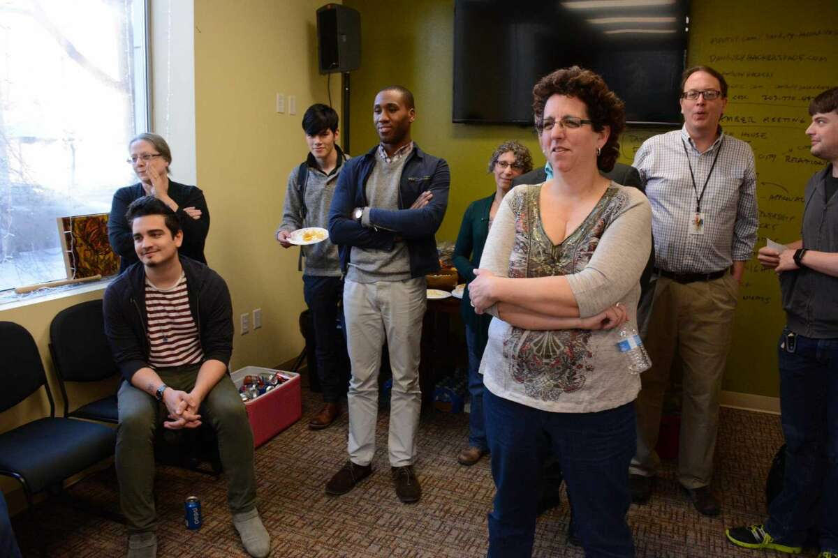 Guests enjoy a professional yoyo artist at the kickstarter for Noteworthy Chocolates on Thursday April 14,2015.