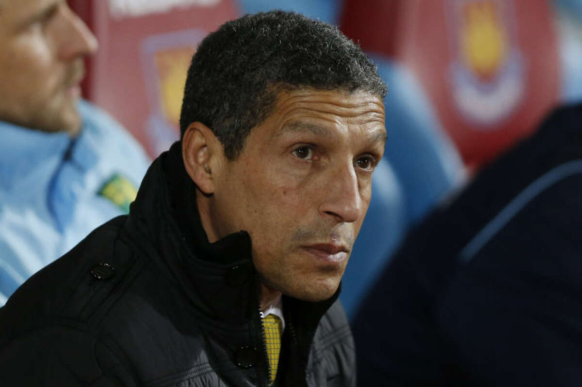 FILE - In this Tuesday, Feb. 11, 2014, file photo, Norwich City's manager Chris Hughton looks on from the dugout before the start of their English Premier League soccer match against West Ham United at Upton Park, London. The Premier League club fired Hughton because it is petrified of a costly relegation. After losing to West Bromwich on Saturday, the team is five points above the relegation zone with five matches remaining, Delia Smith, the co-owner who made her name and fortune from cook books and television shows, will fear missing out on at least $60 million in television revenue next season in the second tier. (AP Photo/Sang Tan, File)