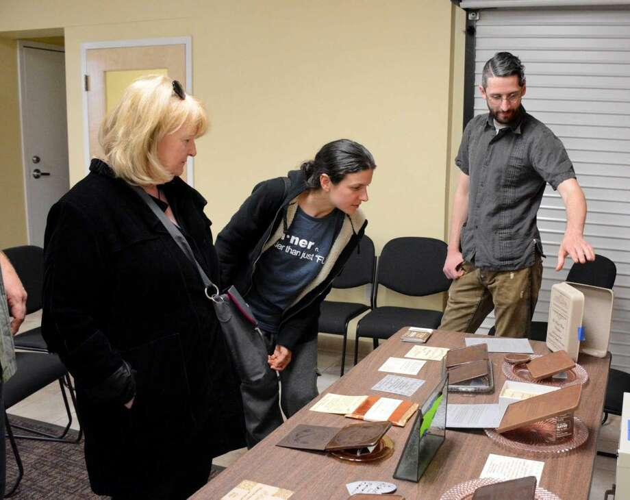 Guests at a kickstarter fundraiser for Noteworthy Chocolates takes a look at their display samples on Thursday April 14 2016.