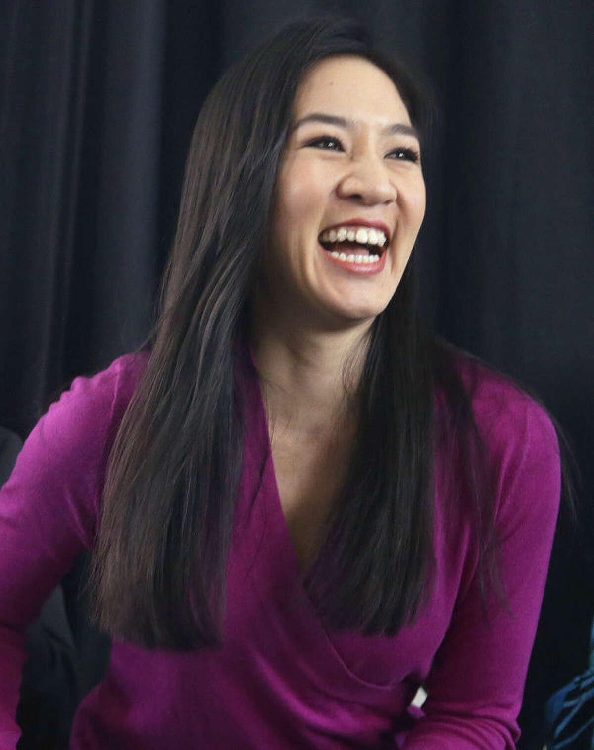 FILE - In this Jan. 28, 2014 file photo, two-time Olympic figure skating medalist Michelle Kwan smiles as she prepares to introduce her husband Clay Pell during his announcement for a run at the governorship of the state of Rhode Island, in Providence, RI. On Monday, March 7, 2014, Kwan was to be surrounded by more than a dozen of her fellow champions and honored by the unique Figure Skating in Harlem, a program for which she has provided inspiration for 16 years. (AP Photo/Stephan Savoia, File)