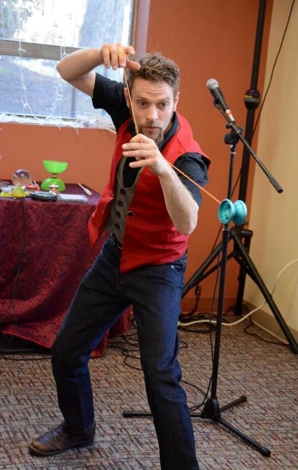 Bending Gravity Entertainments Eric Girardi performs with a yoyo at Notworthy Chocolates Kicksarter event on Thursday April 14, 2016.
