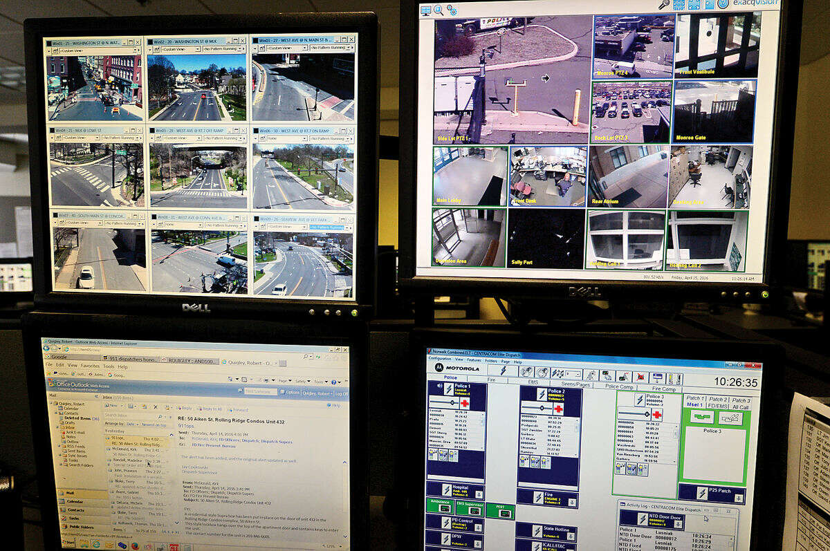 Multiple screens watch security cameras locally and along Interstate 95 from the third-floor dispatch office at Norwalk Police Department Friday, April 15, 2016.