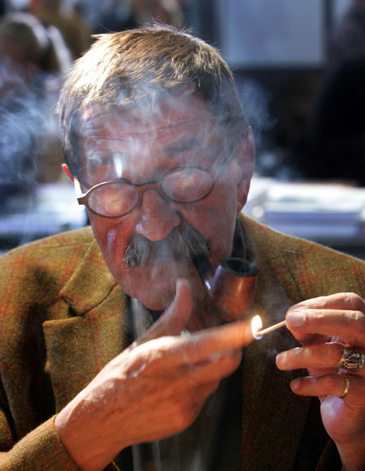 FILE - In this Oct. 6, 2006 file photo literature nobel prize winner Guenter Grass smokes a pipe at the Book Fair in Frankfurt, central Germany. Nobel laureate Grass has died his publishing house confirmed Monday, April 13, 2015. He was 87. (AP Photo/Michael Probst, file)