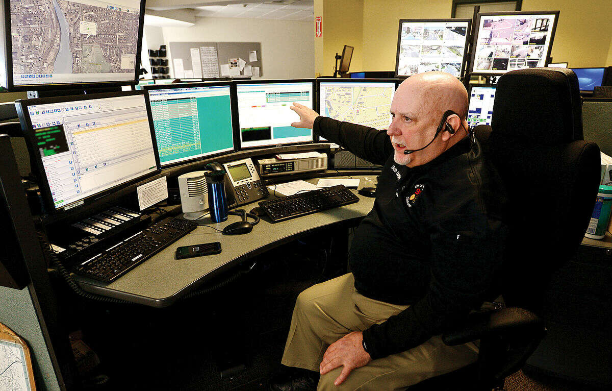 Emergency Dispatch Supervisor Bob Quigley points out the information that comes into the third-floor dispatch office at Norwalk Police Department Friday, April 15, 2016.