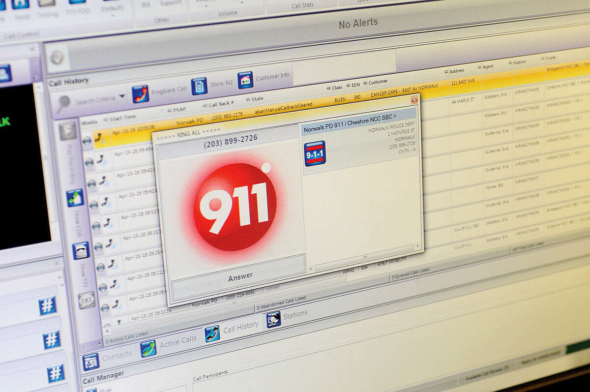 A 911 call comes into the third-floor dispatch office at Norwalk Police Department Friday, April 15, 2016.