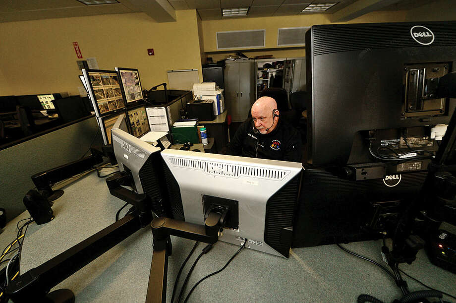 Emergency Dispatch Supervisor Bob Quigley takes calls in the third-floor dispatch office at Norwalk Police Department Friday, April 15, 2016.