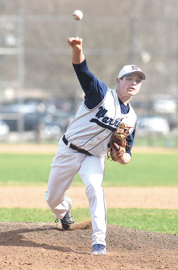 Hour photo/John Nash - Wilton pitcher Jackson Ward fires to the plate during Monday's game against Greenwich. Ward, who pitched a no-hitter in the season-opener, gave up two unearned runs in a hard-luck 2-1 loss to the Cardinals.