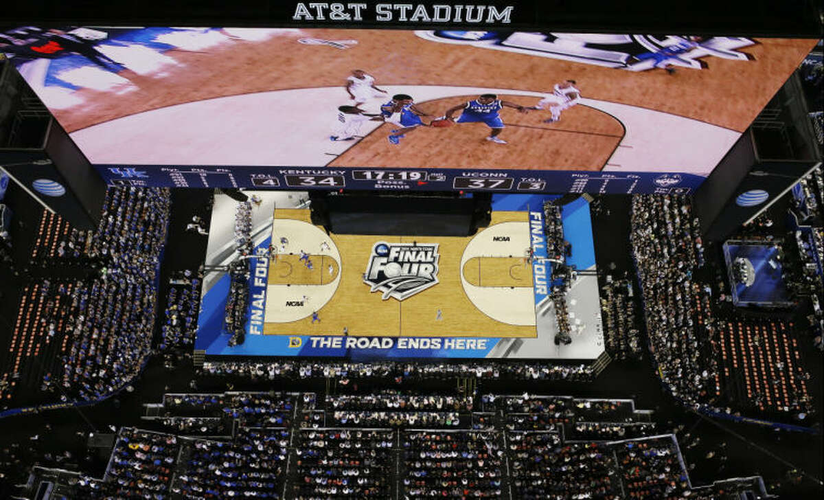 Kentucky and Connecticut compete during the second half of the NCAA Final Four tournament college basketball championship game Monday, April 7, 2014, in Arlington, Texas. (AP Photo/David J. Phillip)