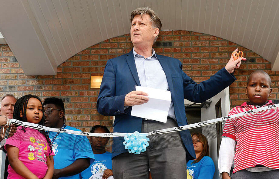 Hour photo / Erik Trautmann Norwalk Grass Roots Tennis Executive Director Chris Hulse speaks during the ribbon-cutting ceremony for their new headquarters and youth center at the old Nathaniel Ely School at 11 Ingalls Ave. Friday. GE Capital volunteers spent three days renovating the space ready for grand opening.
