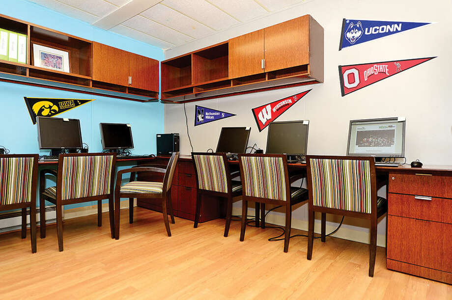 Hour photo / Erik Trautmann The new Norwalk Grass Roots Tennis headquarters and youth center at the old Nathaniel Ely School at 11 Ingalls Ave features a computer room. GE Capital volunteers spent three days renovating the space ready for grand opening.