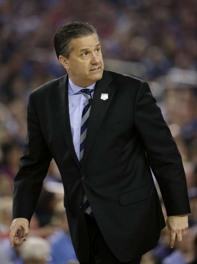 Kentucky head coach John Calipari looks on during the first half of the NCAA Final Four tournament college basketball championship game against Connecticut Monday, April 7, 2014, in Arlington, Texas. (AP Photo/David J. Phillip)