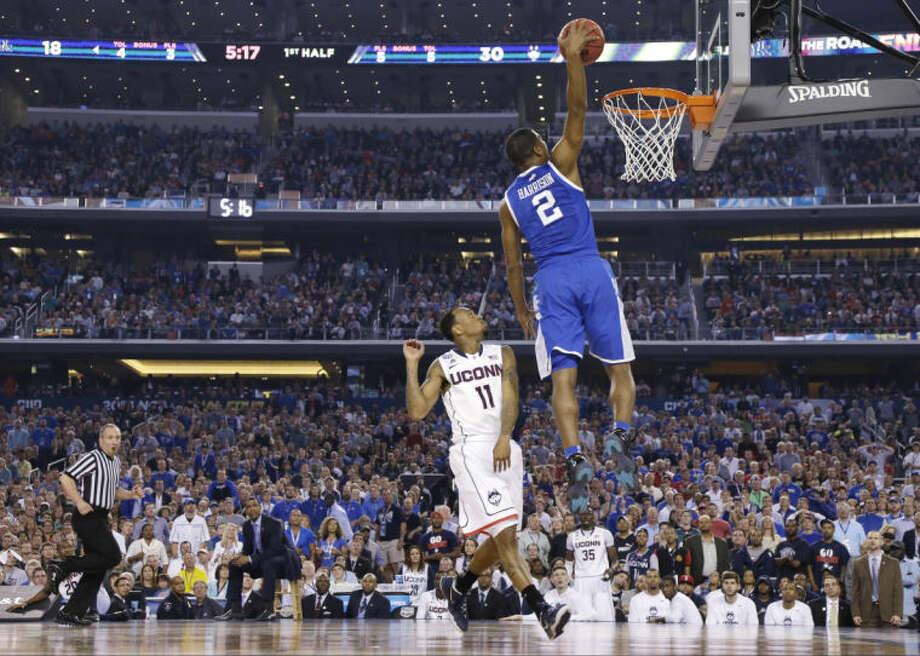 Kentucky guard Aaron Harrison (2) drives to the basket past Connecticut guard Ryan Boatright (11) during the first half of the NCAA Final Four tournament college basketball championship game Monday, April 7, 2014, in Arlington, Texas. (AP Photo/Eric Gay)