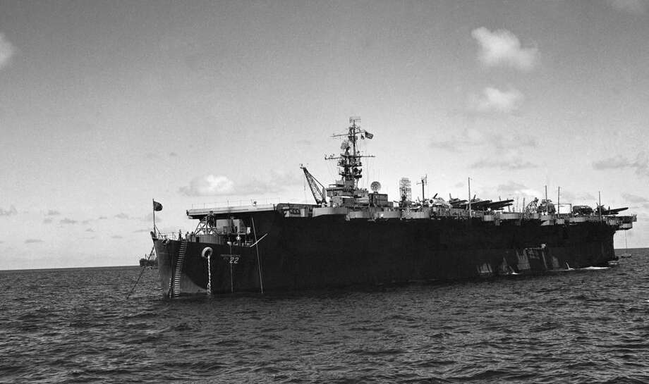 File - In this July 1946 file photo is the USS Independence near Bikini Atoll. Scientists have rediscovered a mostly intact World War II aircraft carrier the U.S. Navy scuttled off the Northern California coast decades ago. The U.S.S. Independence was located and video recorded as part of a National Oceanic and Atmospheric mission to locate and map an estimated 300 historic shipwrecks in the waters outside San Francisco's Golden Gate Bridge. Images captured by a remotely controlled miniature submarine showed the Independence sitting upright about 30 miles west of the coast and near the Farallon Islands. (AP Photo/Clarence Hamm, File)