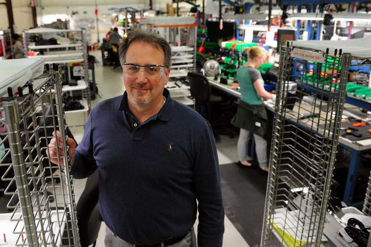David Black, VP of Engineering at Electri-Cable Assemblies, poses on the factory floor in Shelton, Conn., on Thursday Apr. 14, 2016. An extra federal unemployment tax , which was imposed on businesses after the Great Recession in 2009, will be coming to an end soon.