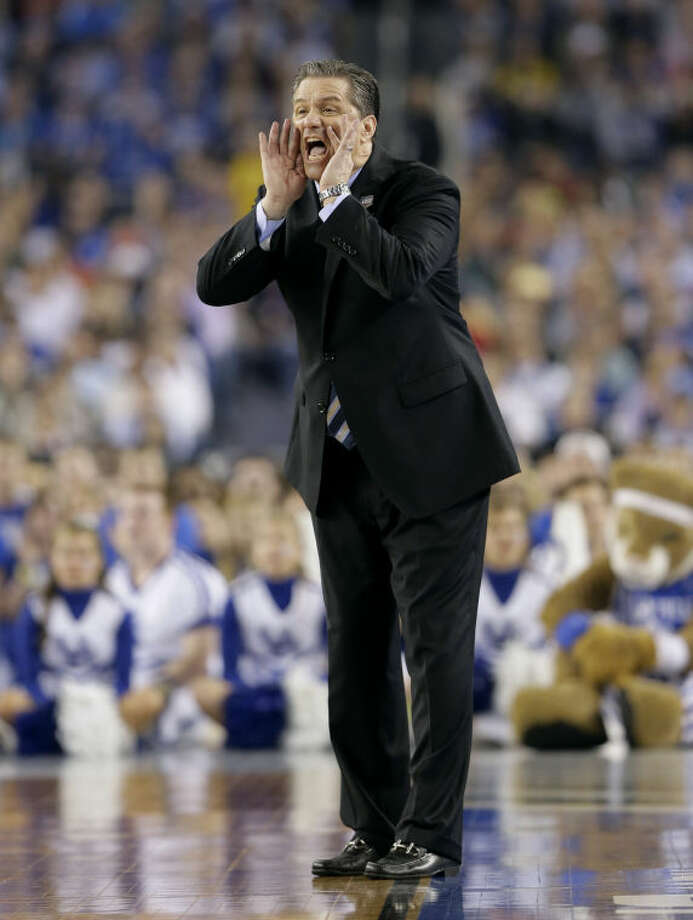Kentucky head coach John Calipari shouts to his team during the first half of the NCAA Final Four tournament college basketball championship game against Connecticut Monday, April 7, 2014, in Arlington, Texas. (AP Photo/Eric Gay)