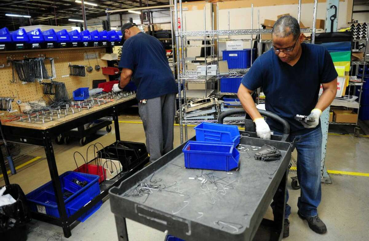 Factory work going on at Electri-Cable Assemblies in Shelton, Conn., on Thursday Apr. 14, 2016. An extra federal unemployment tax, which was imposed on businesses after the Great Recession in 2009, will be coming to an end soon.