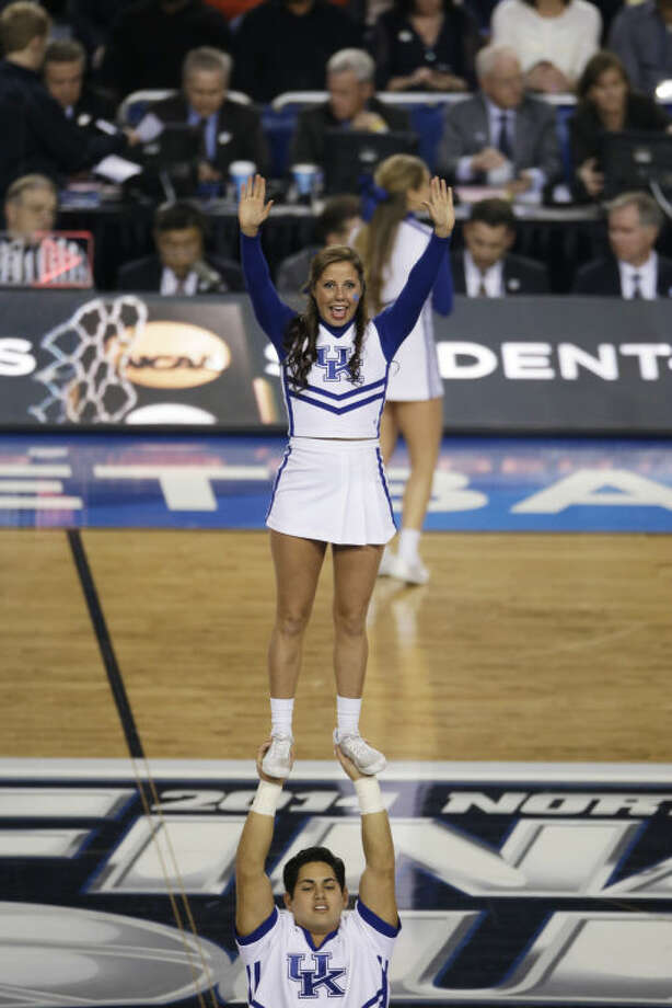 Kentucky cheerleaders perform during the first half of the NCAA Final Four tournament college basketball championship game against Connecticut Monday, April 7, 2014, in Arlington, Texas. (AP Photo/Tony Gutierrez)