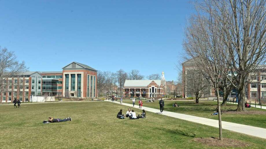 Students take advantage of the warm weather on the Student Union Mall of the University of Connecticut campus, on Thursday, April 14, 2016, in Storrs, Conn.