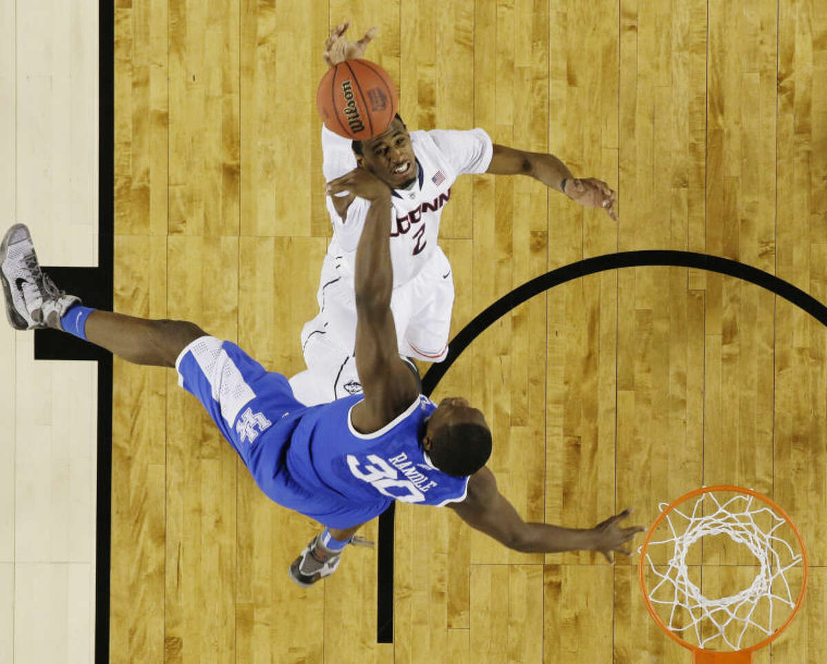 Connecticut forward DeAndre Daniels (2) shoots as Kentucky forward Julius Randle (30) defends during the first half of the NCAA Final Four tournament college basketball championship game Monday, April 7, 2014, in Arlington, Texas. (AP Photo/David J. Phillip)